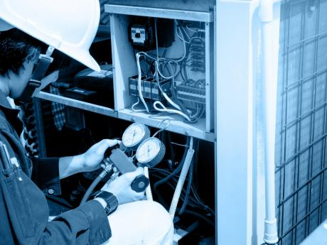 Technician Testing HVAC Equipment
