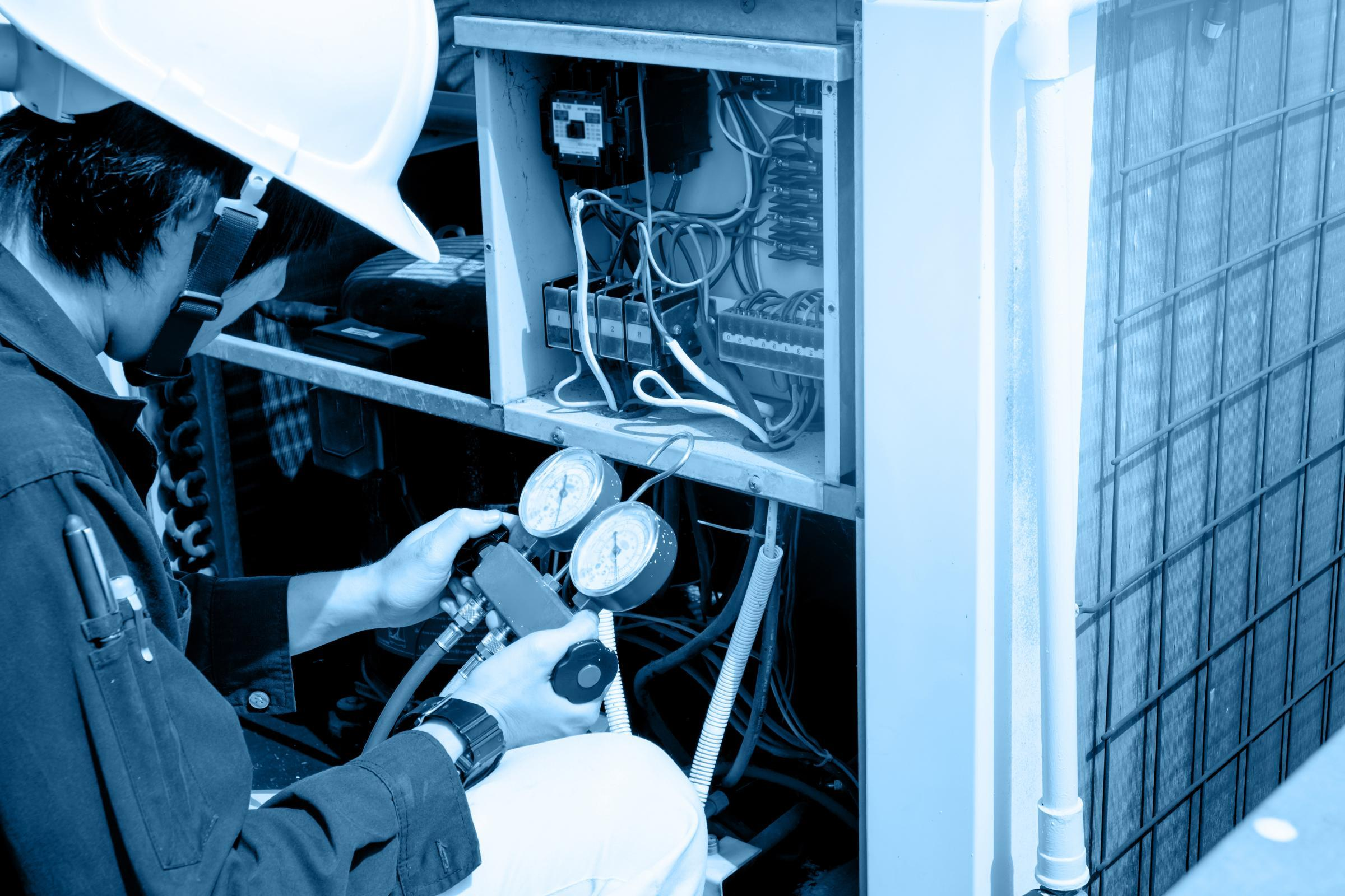 Technician Testing HVAC Equipment